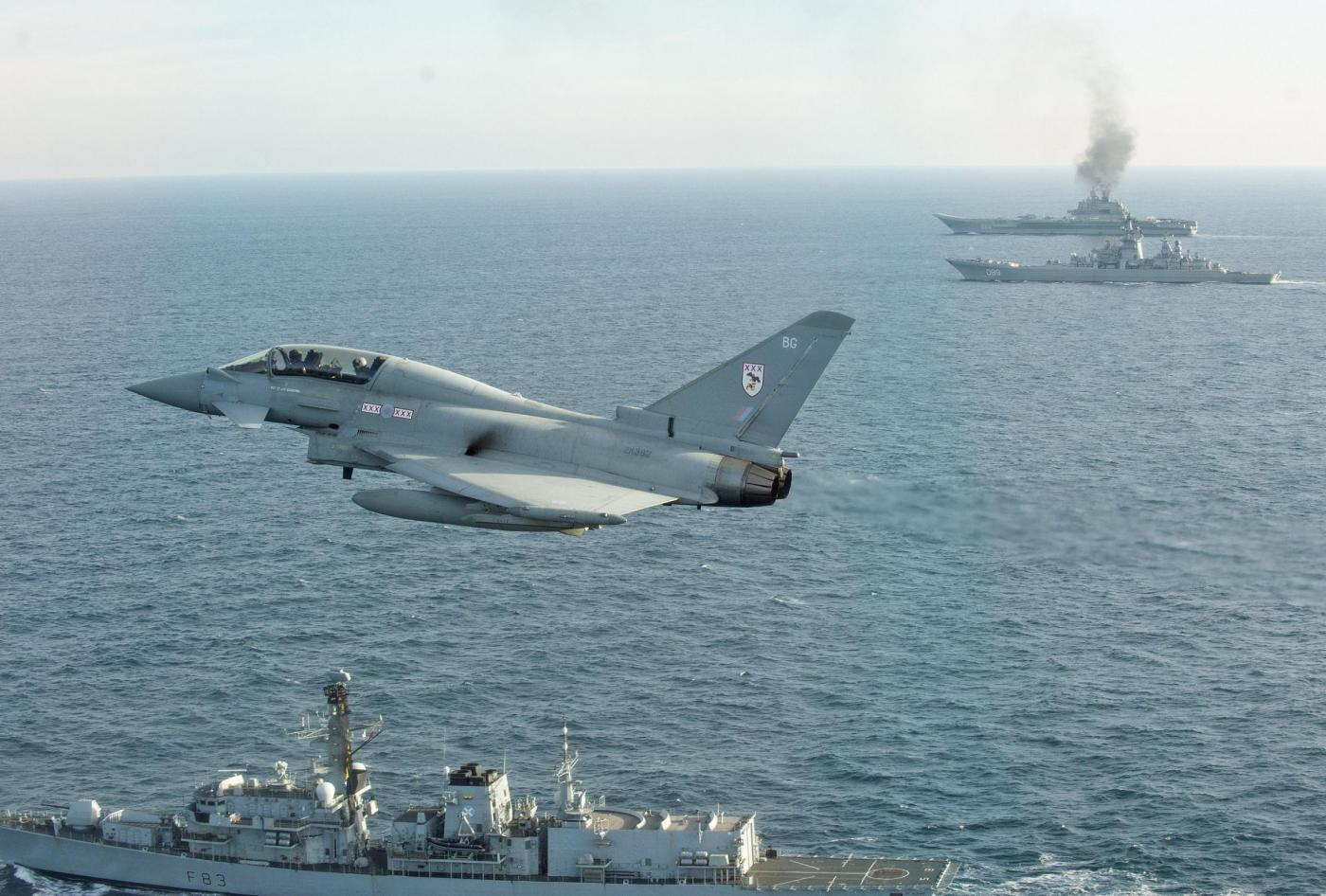 Undated handout photo issued by the MoD of HMS St Albans and an RAF Typhoon (foreground), with the Russian Warships Petr Velikiy (centre) and the Admiral Kuznetsov (background) as they transit near to our sovereign waters on their way back to Russia. PRESS ASSOCIATION Photo. Issue date: Wednesday January 25, 2017. See PA story DEFENCE Russia. Photo credit should read: MoD Crown Copyright/PA Wire  NOTE TO EDITORS: This handout photo may only be used in for editorial reporting purposes for the contemporaneous illustration of events, things or the people in the image or facts mentioned in the caption. Reuse of the picture may require further permission from the copyright holder.