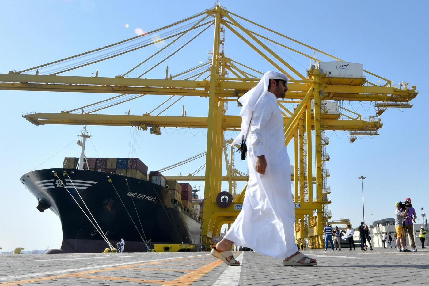 A man walks in front of container ship of MSC Sao Paulo is docks unloading containers at the Hamad port in Doha, capital of Qatar, June 14,2017.Qatar announced on 12 June it would ship cargo via Oman after maritime authorities in Saudi Arabia, the UAE, Yemen, Egypt and Bahrain indefinitely suspended all shipping to and from Qatar. (Xinhua / Nikku )