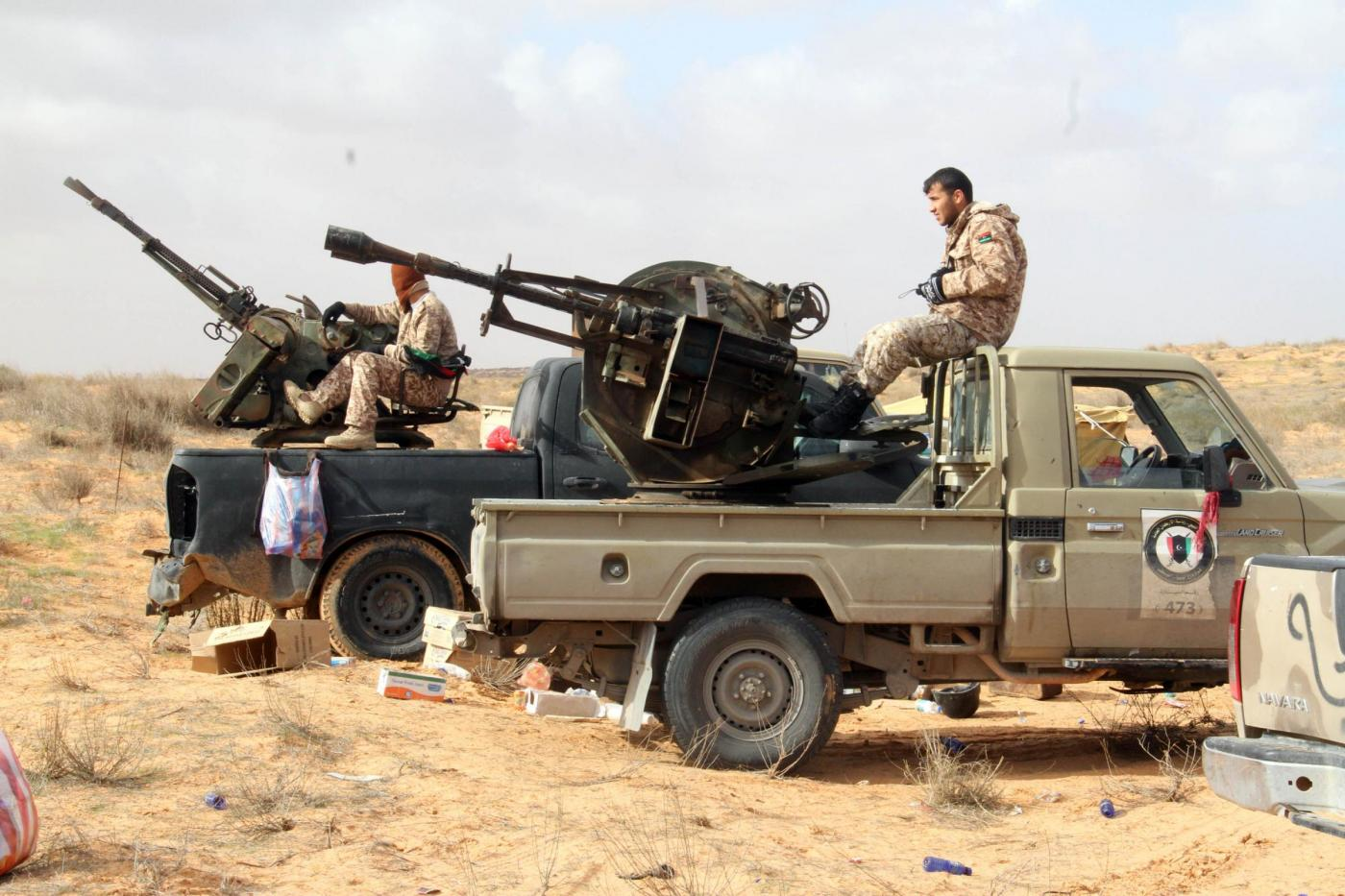 (150105) -- TRIPOLI, Jan. 5, 2015 (Xinhua) -- Some Libya Dawn fighters have a rest near Wetia airbase, Libya, on Jan. 5, 2015. Clashes continued between Libya Dawn fighters and pro-government forces on Monday near Wetia airbase, some 170 kilometers southwest of the capital Tripoli.(Xinhua/Hamza Turkia)