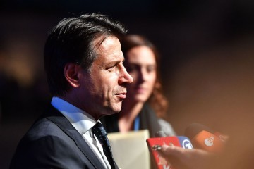 Italian Prime Minister Giuseppe Conte speaks to the media as he arrives at the Felsenreitschule prior to their informal dinner as part of the EU Informal Summit of Heads of State or Government in Salzburg, Austria on September 19, 2018. (Photo by JOE KLAMAR / AFP)