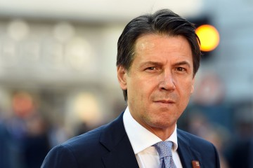 Italian Prime Minister Giuseppe Conte arrives at the Mozarteum University to attend a plenary session part of the EU Informal Summit of Heads of State or Government in Salzburg, Austria, on September 20, 2018. (Photo by Christof STACHE / AFP)