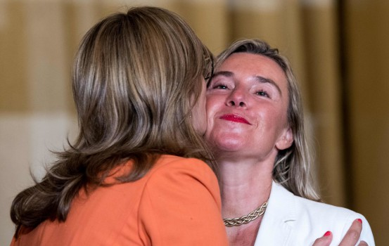 Bulgarian Foreign Minister Ekaterina Zakharieva (L) greets European Union Foreign Policy Chief Federica Mogherini during the Women Foreign Ministers' Meeting in Montreal, Canada, on September 21, 2018. - Women foreign ministers from around the world kicked off a first-of-its-kind meeting on Friday, bringing together more than half of the world's top women diplomats in Montreal. (Photo by MARTIN OUELLET-DIOTTE / AFP)