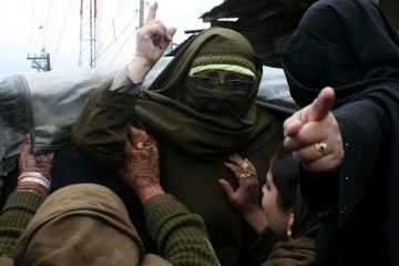 Indian police detain female activists of Jammu Kashmir Mass Movement, JKMM, wearing green headbands during a protest in Srinagar, Kashmir, India. March 20, 2009.