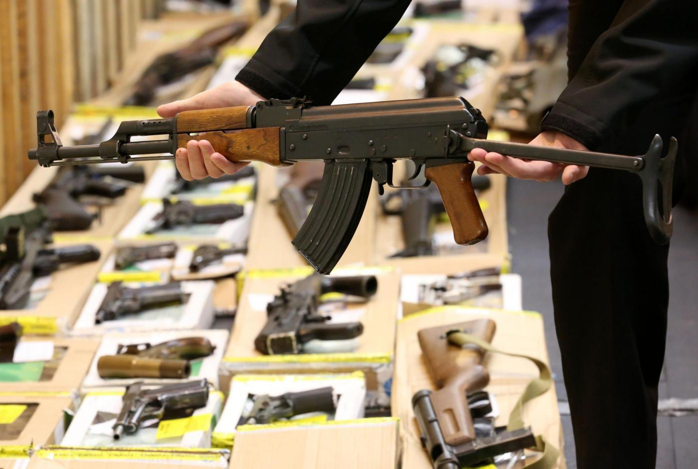 An AK47 on display at Suffolk Police Headquarters at Martlesham in Suffolk which was found at the house of James Arnold, part of the the biggest hoard of illegal weapons ever uncovered in the UK. PRESS ASSOCIATION Photo. Issue date: Friday February 19, 2016. Police found 463 illegal firearms, including rifles, machine guns and an anti-tank missile, along with 200,000 rounds of ammunition in a secret room at the home of crane operator and parish council chairman James Arnold, 49, in the village of Wyverstone, Suffolk as Anthony Buckland. a firearms dealer, has been jailed for six years for suppling a small number of the weapons. See PA story COURTS Firearms. Photo credit should read: Chris Radburn/PA Wire