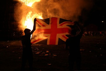 "The huge bonfire  in the Shankill Road in Belfast  is lit on the ""Eleventh night"" to usher in the Twelfth commemorations. PRESS ASSOCIATION Photo. Picture date: Monday July 11, 2016. See PA story ULSTER Twelfth. Photo credit should read: Niall Carson/PA Wire"