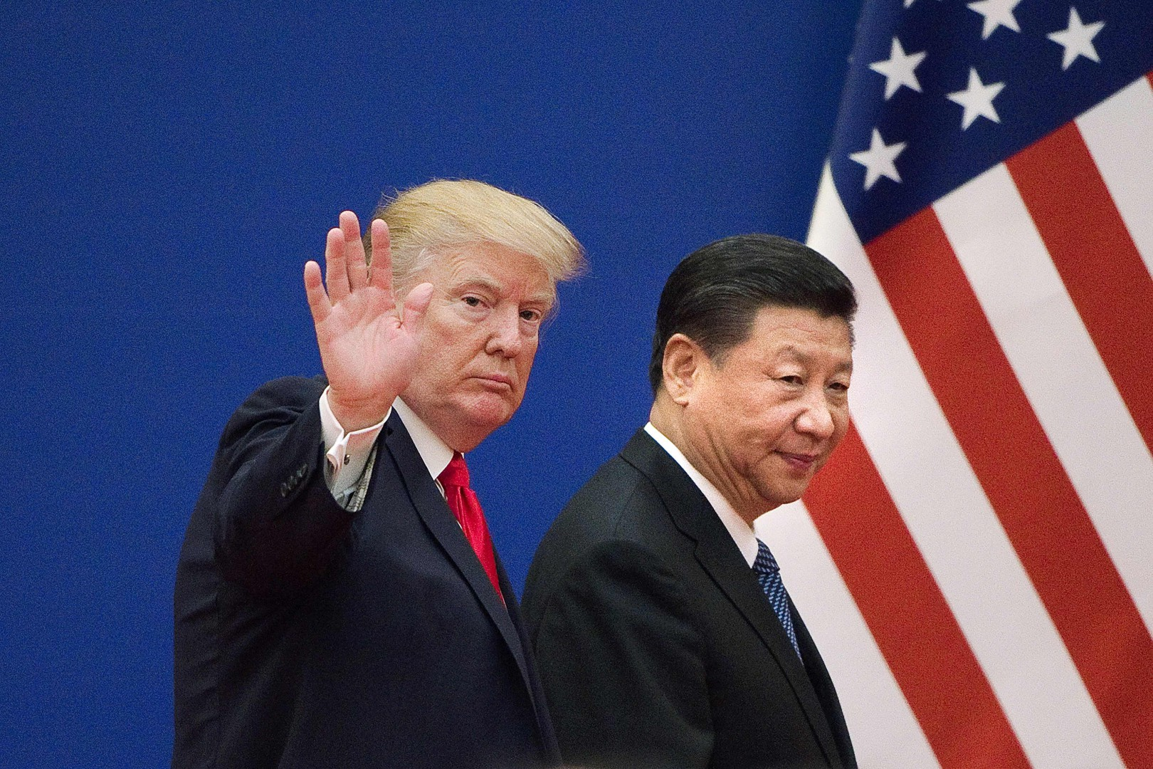 """(FILES) In this file photo taken on November 9, 2017 shows US President Donald Trump (L) and China's President Xi Jinping leaving a business leaders event at the Great Hall of the People in Beijing. - US President Donald Trump on August 24, 2018 announced the cancellation of his top diplomat's upcoming visit to North Korea, while taking a swipe at China over efforts to disarm the nuclear state. Trump says China is not 'helping' with North Korea. """"Additionally, because of our much tougher Trading stance with China, I do not believe they are helping with the process of denuclearization as they once were (despite the UN Sanctions which are in place),"""" Trump said. (Photo by Nicolas ASFOURI / AFP)"""