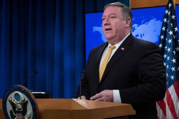 """US Secretary of State Mike Pompeo speaks during a press briefing at the US Department of State in Washington, DC, on October 3, 2018. - The United States said Wednesday it was terminating a 1955 treaty reached with then ally Iran after Tehran cited it in an international court ruling against Washington's sanctions policy. """"I'm announcing that the US is terminating the 1955 Treaty of Amity with Iran. This is a decision, frankly, that is 39 years overdue,"""" Secretary of State Mike Pompeo told reporters, referring to the date of the 1979 Islamic revolution. (Photo by Jim WATSON / AFP)"""