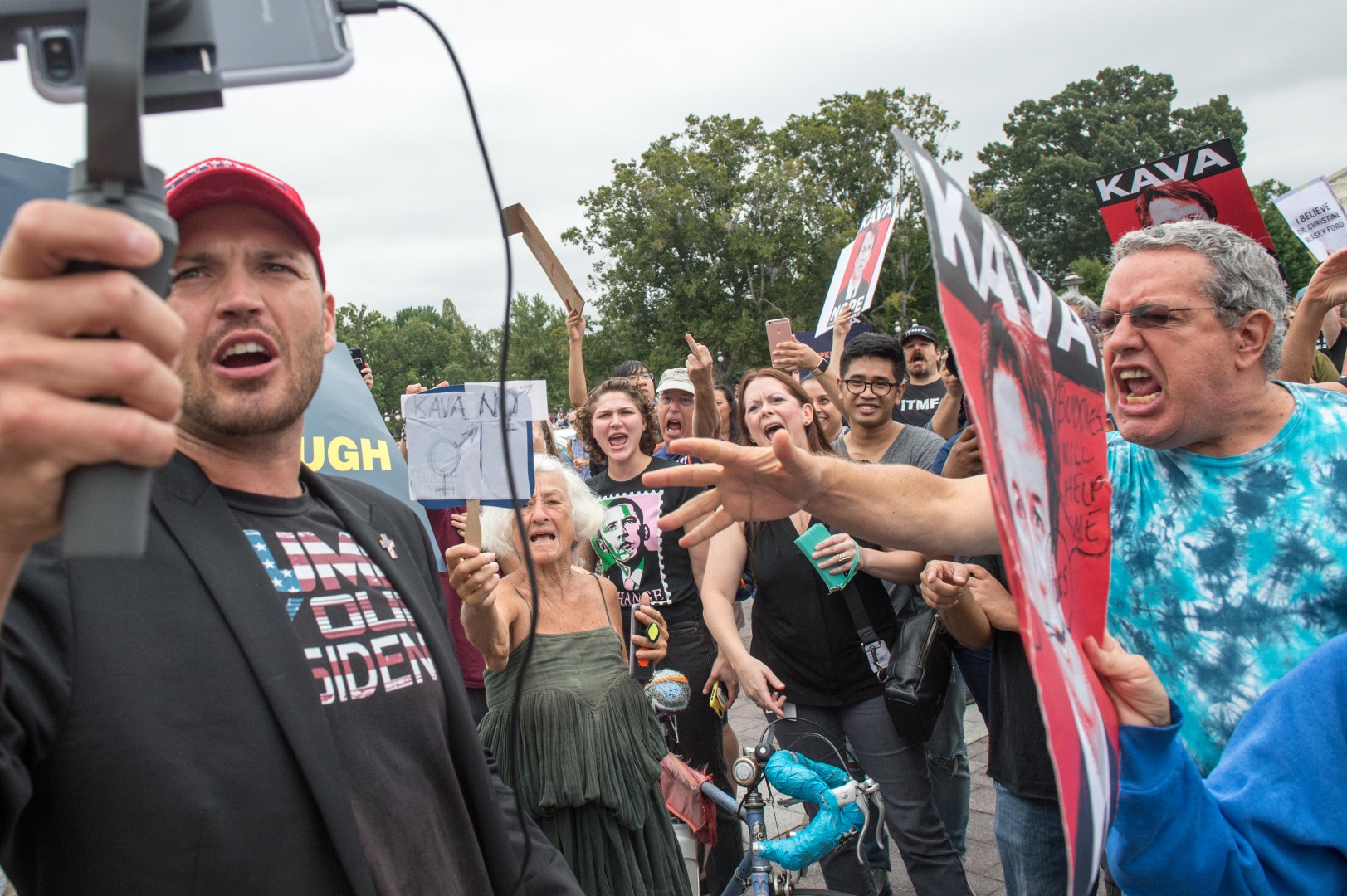 A Trump supporter is heckled by anti-Kavanaugh demonstrators protesting against the appointment of Supreme Court nominee Brett Kavanaugh in Washington DC, on October 6, 2018. - The US Senate confirmed conservative judge Kavanaugh as the next Supreme Court justice on October 6, offering US President Donald Trump a big political win and tilting the nation's high court decidedly to the right. (Photo by ROBERTO SCHMIDT / AFP)