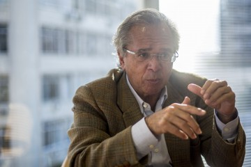 In this file photo taken on August 21, 2018, Brazilian economist of Brazil's right-wing presidential candidate for the Social Liberal Party (PSL) Jair Bolsonaro, Paulo Guedes, talks to the media in Rio de Janeiro, Brazil. - A deeply polarized Brazil stood at a political crossroads on October 8, 2018 as the bruising first round of the presidential election left voters with a stark choice in the run-off between far-right firebrand Jair Bolsonaro and leftist Fernando Haddad. Bolsonaro won 46 percent of the vote to Haddad's 29 percent, according to official results. (Photo by Daniel RAMALHO / AFP)