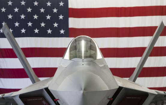 (FILES) In this file photo taken on December 15, 2015 a US Air Force Lockheed Martin F-22 Raptor stealth fighter aircraft is parked inside a hangar at Joint Base Langley-Eustis in Hampton, Virginia. - The United States Air Force said October 14, 2018 that a group of F-22 stealth fighters left behind at a base to ride out Hurricane Michael were intact but it was too soon to say whether all of them would fly again. Tyndall Air Force Base in Florida was hit by the Category 4 storm on October 10 and suffered extensive damage, with some hangars partially stripped of their roofs, according to official footage of the coastal facility. (Photo by Saul LOEB / AFP)