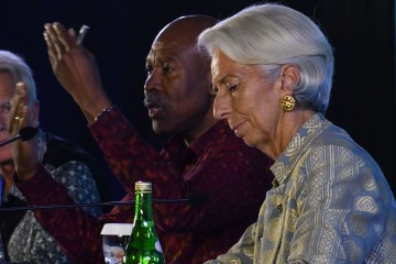 Lesetja Kganyago (R), governor of the South African Reserve Bank, speaks during a press conference with International Monetary Fund Managing (IMF) director Christine Lagarde at the International Monetary Fund (IMF) and World Bank annual meetings in Nusa Dua, on Indonesia's resort island of Bali on October 13, 2018. (Photo by Goh Chai Hin / AFP)