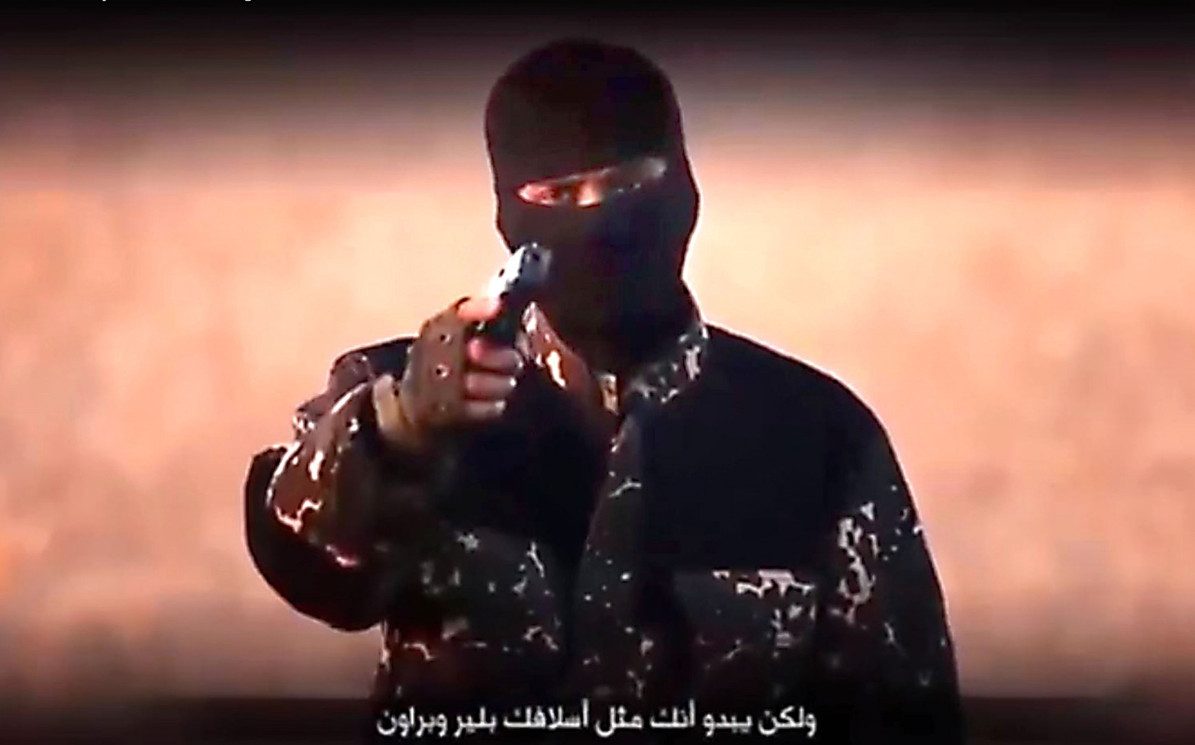 "BEST QUALITY AVAILABLE  Screen grab taken from YouTube from undated footage issued by Islamic State militants showing a masked jihadi with a British accent mocking David Cameron in a purported new Islamic State video showing the execution of five men accused of being spies for the UK. PRESS ASSOCIATION Photo. Issue date: Monday January 4, 2016. The footage released online shows the man waving a gun as he references Britain's ""handful of planes"" carrying out air attacks on IS targets in Iraq and Syria.The footage, which has yet to be independently verified, shows then five men ""confessing"" to filming and photographing sites in exchange for money within Raqqa, the capital of the Islamic State group's self-declared caliphate. See PA story POLITICS IS. Photo credit should read: YouTube/PA Wire  NOTE TO EDITORS: This handout photo may only be used in for editorial reporting purposes for the contemporaneous illustration of events, things or the people in the image or facts mentioned in the caption. Reuse of the picture may require further permission from the copyright holder."