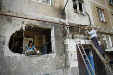 YASINOVATAYA, UKRAINE - August 1: Aftermath of heavy shelling, in Yasinovataya, Ukraine on August 1, 2016.As minimum one person dead and several were injured as a result of artillery clash between Ukrainian troops and rebels. Several appartment houses were seriously damaged.