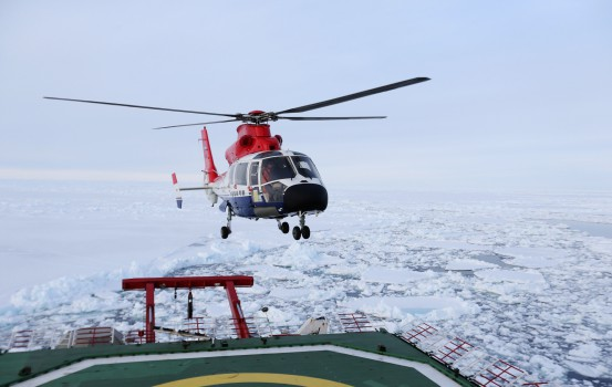 (171205) -- ABOARD XUELONG, Dec. 5, 2017 (Xinhua) -- A helicopter of China's research icebreaker Xuelong, or Snow Dragon, detects the ice situation in the Antarctic Circle, Dec. 4, 2017. Xuelong has entered the Antarctic Circle as of press time. It set sail from Shanghai, east China, on Nov. 8, beginning the country's 34th Antarctic expedition. Researchers will conduct preliminary work on China's fifth station in the Antarctica, which is one of the key objectives of this expedition.  (Xinhua/Bai Guolong) (ry)