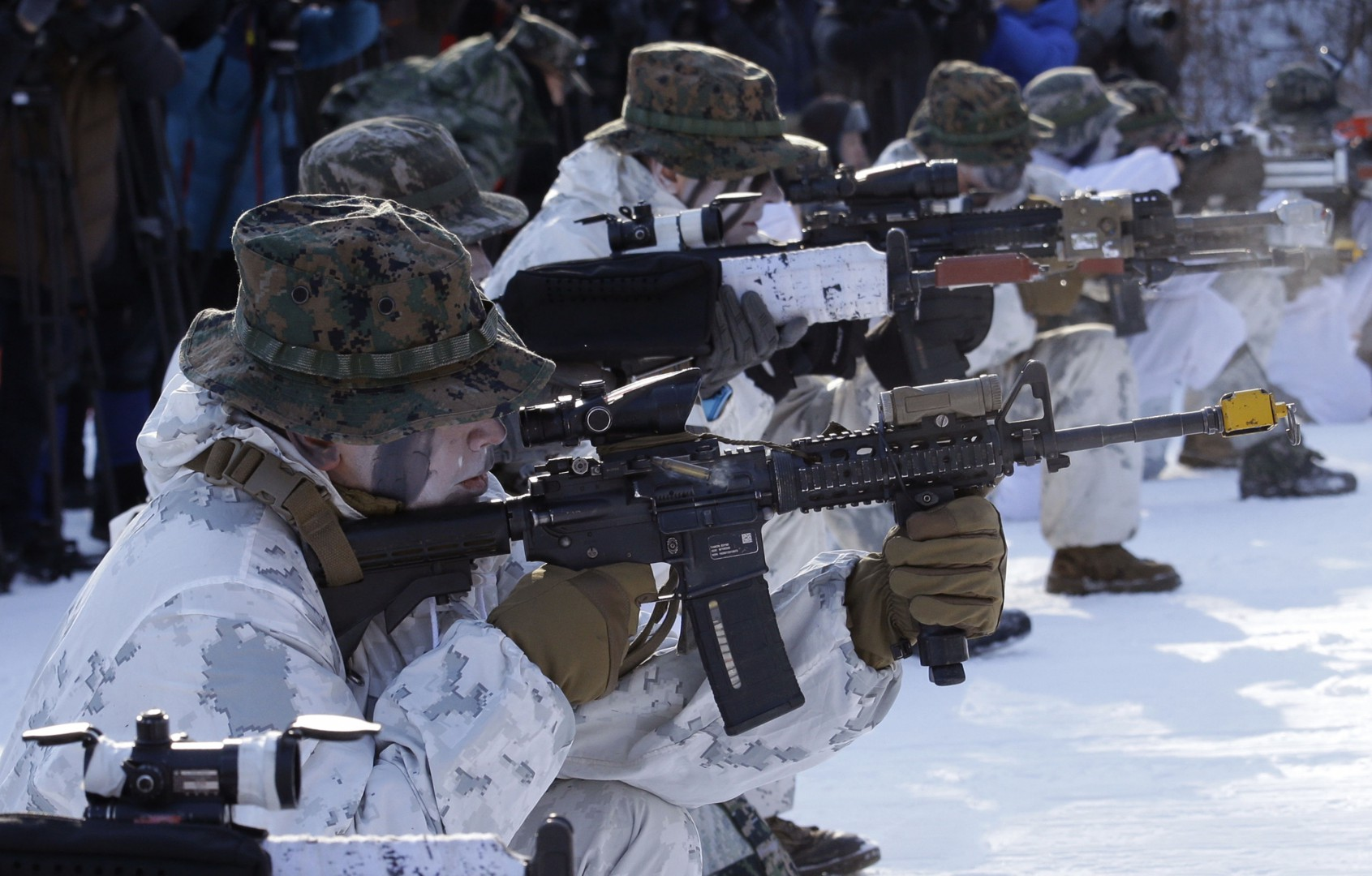 South Korean and U.S. Marines from III Marine Expeditionary Force from Okinawa, Japan, fire their machine guns during their joint military winter exercise in Pyeongchang, South Korea, Tuesday, Dec. 19, 2017. More than 400 marines from the two countries participated in the Dec. 4-22 joint winter exercise in South Korea. (AP Photo/Ahn Young-joon)
