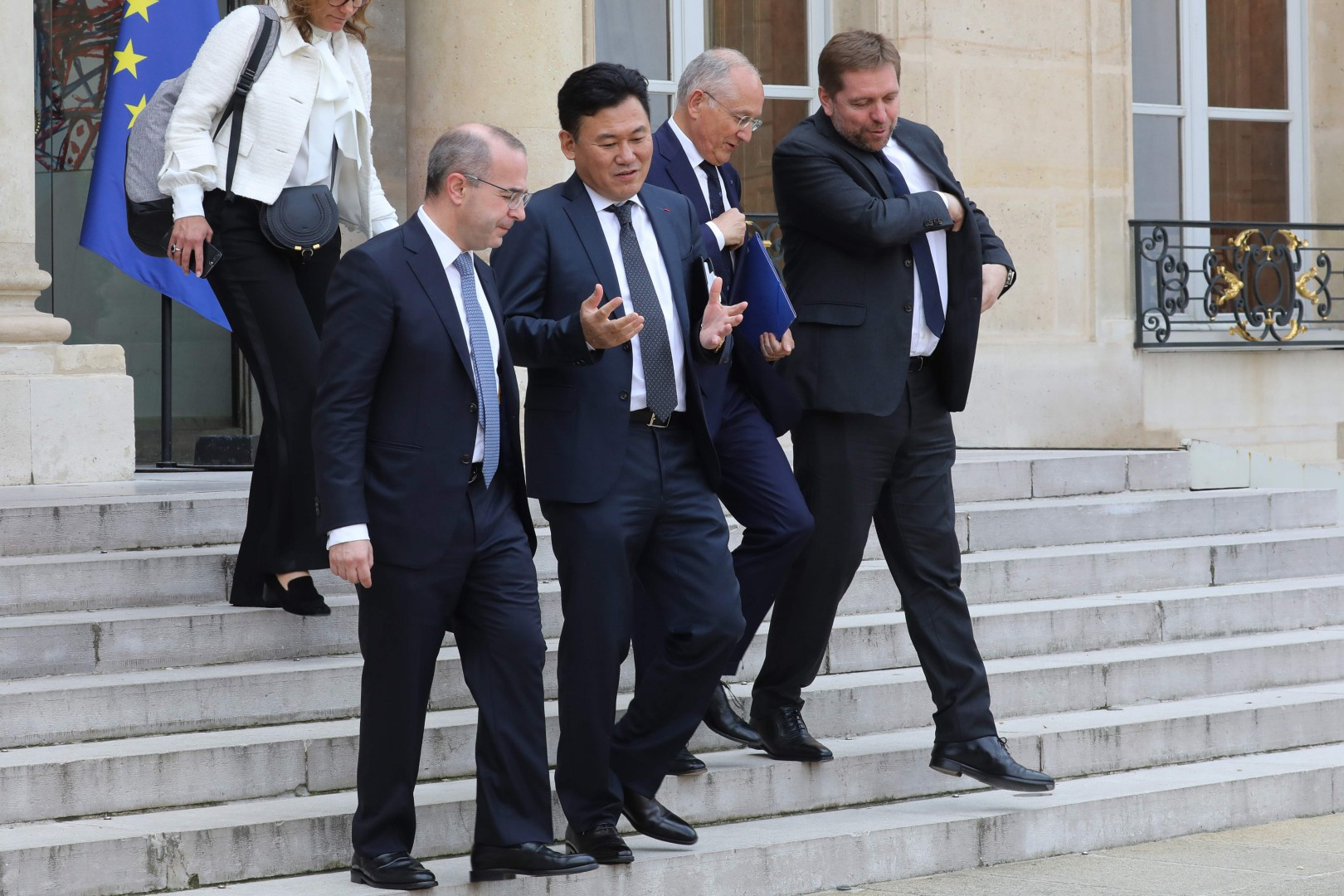 """Rakuten CEO Hiroshi Mikitani (C), Groupe La Poste COE Philippe Wahl (2ndR) and CEO of Qwant Eric Leandri (R) they leave after the """"Tech for Good"""" Summit at the Elysee Palace in Paris, on May 23, 2018. / AFP PHOTO / ludovic MARIN"""