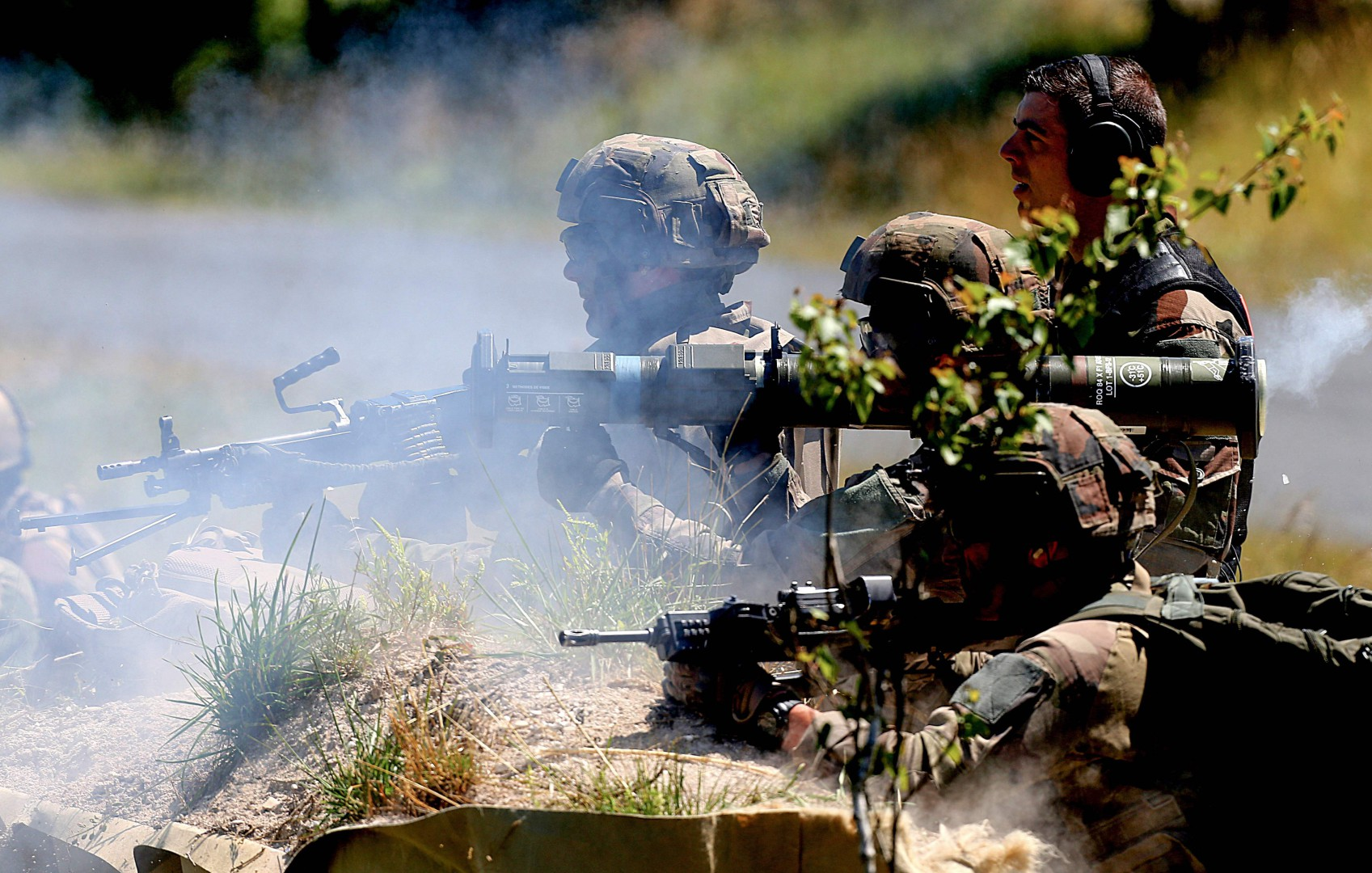 French army soldiers fire live ammunitions as they participate on June 26, 2018, in military manoeuvres at the Combined Armed Forces Shooting Training Center (CETIA-S) in Suippes, eastern France. The 17,000 hectares training centre, located in Suippes under the direction of the 51st Infantry Regiment, is the only one in France to give the opportunity to the different army corps to perform live manoeuvres. / AFP PHOTO / FRANCOIS NASCIMBENI