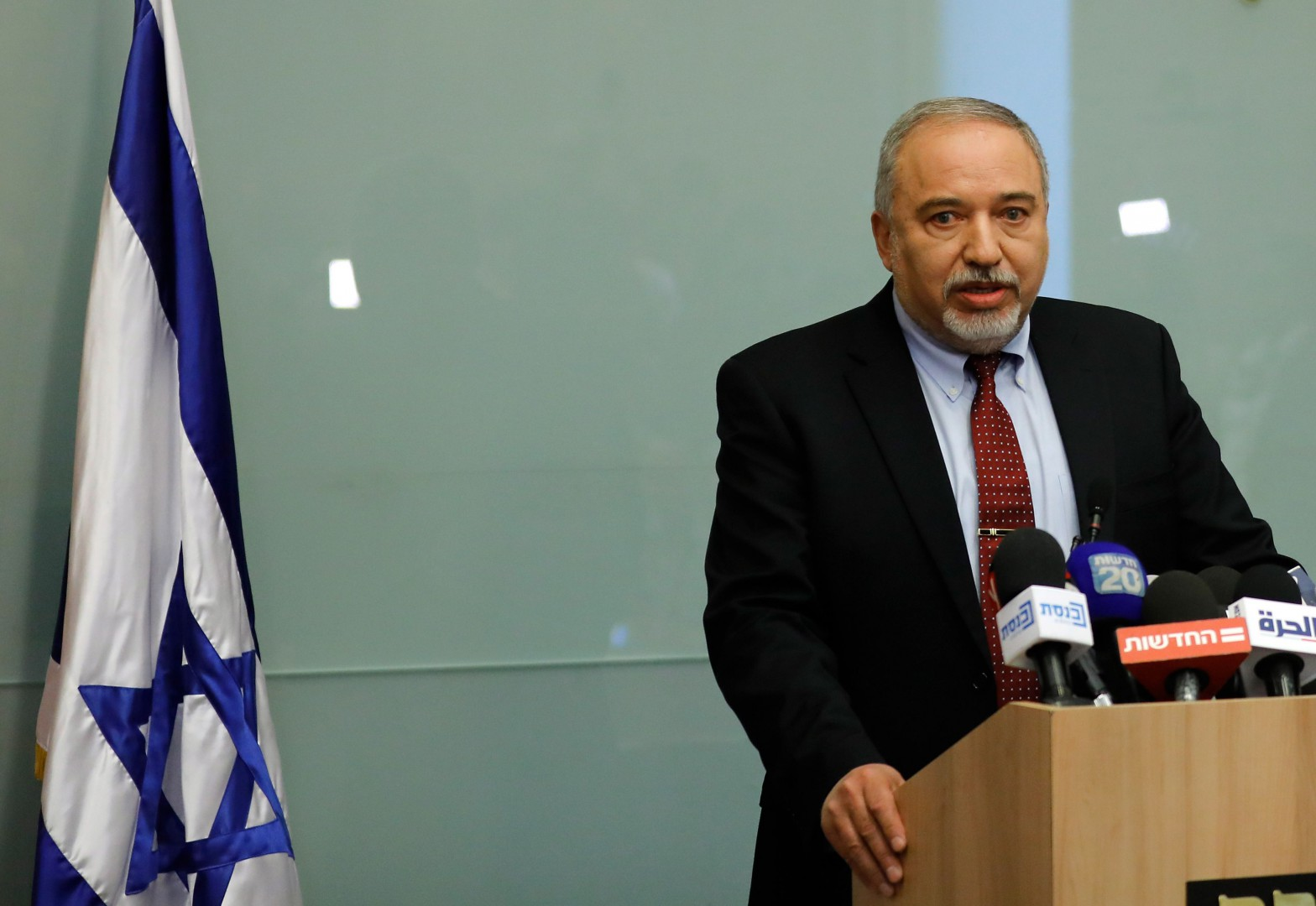 Israeli Defence Minister Avigdor Lieberman speaks during a press conference at the Knesset in Jerusalem on November 14, 2018. - Lieberman announced his resignation today and called for early elections after a sharp disagreement over a Gaza ceasefire deal, throwing the government into turmoil. (Photo by Menahem KAHANA / AFP)