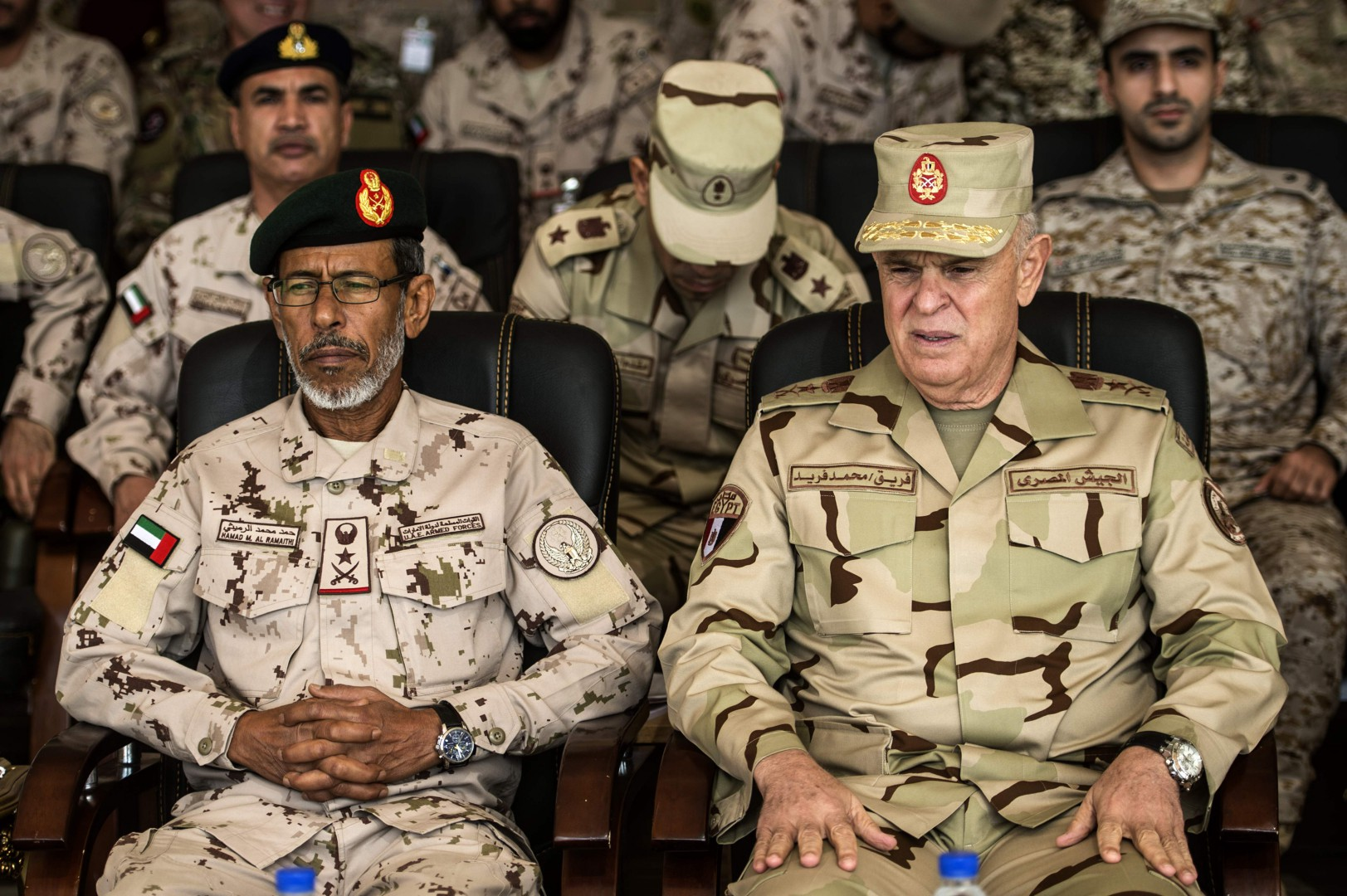 Egyptian army Chief of Staff Mohamed Farid (R), and his Emirati counterpart Hamad Mohammed al-Rumaith the Arab Shield military exercises in the Matrouh Governorate Mohamed Naguib miilitary base, northwest of the capital Cairo on November 15, 2018. - Forces from Saudi Arabia, Egypt, the UAE, Kuwait, Bahrain and Jordan are taking part in the maneuvers. (Photo by Khaled DESOUKI / AFP)