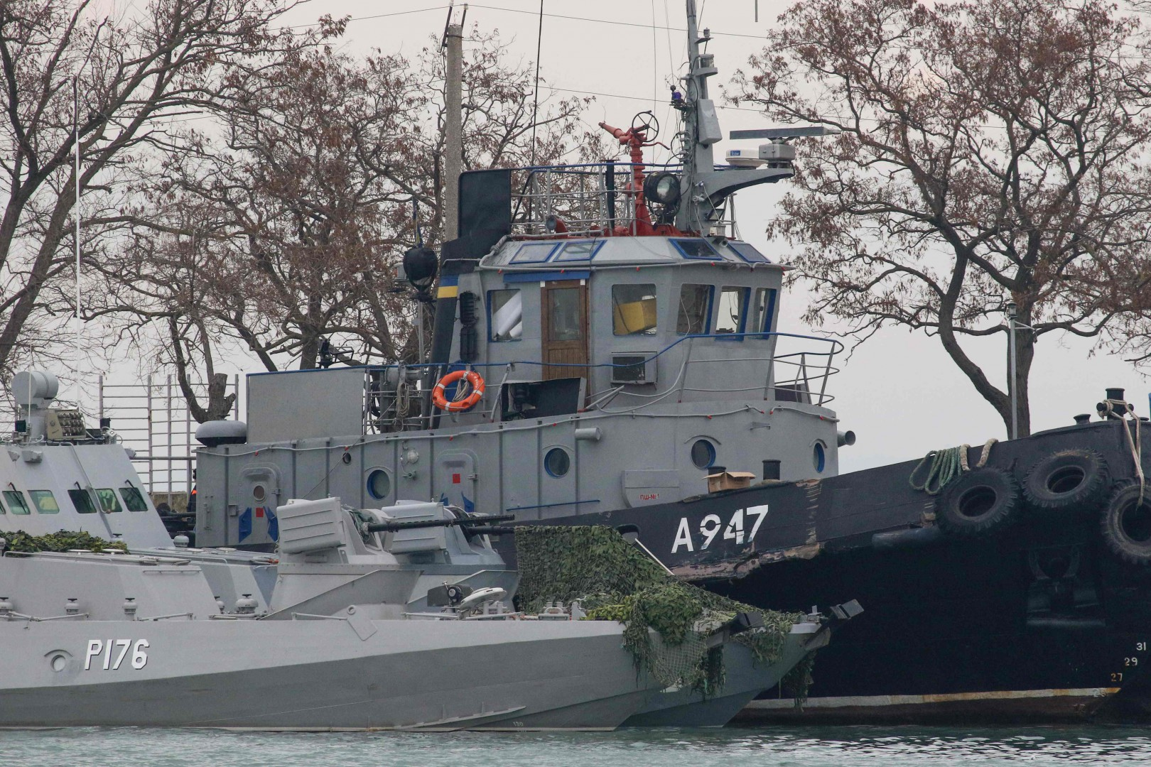 Seized Ukrainian military vessels are seen in a port of Kerch, Crimea, on November 26, 2018. - Kiev and Moscow faced their worst crisis in years on November 26, 2018 as Ukraine and its Western allies demanded the release of three ships fired on and seized by Russia near Crimea. Russian forces boarded and captured the ships on Sunday, with Moscow accusing the vessels of illegally entering Russian waters off the coast of Crimea in the Sea of Azov. (Photo by STR / AFP)