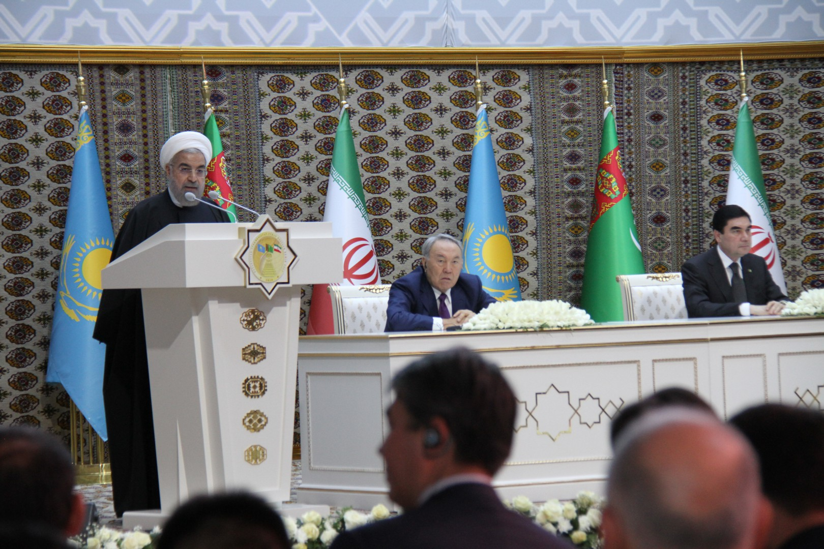 (141204) -- AK YAYLA, Dec. 4, 2014(Xinhua) -- Iranian president Hassan Rouhani (1,L) speaks while Kazakhstan's president Nursultan Nazarbayev (2,L) and Turkmen President Gurbanguly Berdimuhamedowin (1,R) listen during the linking ceremony of the two sections of the international railway between Turkmenistan and Iran in the Turkmen village of Ak Yayla bordering Iran, on December 3, 2014. Kazakhstan's president Nursultan Nazarbayev, Turkmen President Gurbanguly Berdimuhamedow and Iranian president Hassan Rouhani co-inaugurated the new railway route that will improve  the exchange of goods between the three countries. The railway is also a part of transportation artery from coastal city Lianyungang of east China to west Asian counties. (Xinhua/Lu Jingli)(azp)