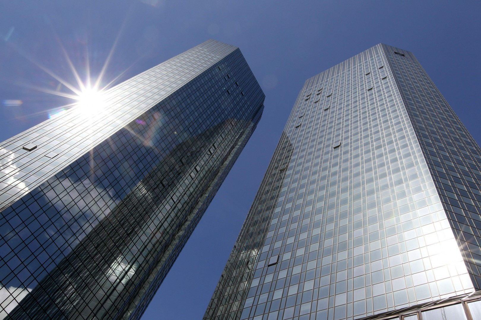 (FILES) In this file photo taken on April 26, 2018 the towers of German Company Deutsche Bank are pictured in Frankfurt, Germany. Germany's biggest lender Deutsche Bank said on July 25, 2018 a major restructuring under its new chief executive was in full swing, as it confirmed second-quarter profits that beat analysts' previous expectations. / AFP PHOTO / Daniel ROLAND