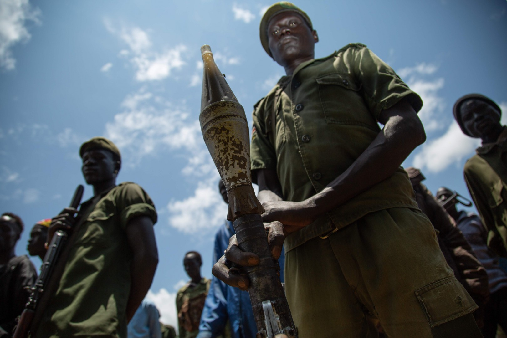 Rebels of the Sudan People's Liberation Movement-in-Opposition (SPLM-IO), a South Sudanese anti-government force, take part in a military exercise at a base in Panyume, on the South Sudanese side of the border with Uganda, on September 22, 2018. - Despite a peace deal being signed by the President of South Sudan, Salva Kiir, and opposition leader Riek Machar on September 12, conflict in Central Equatoria continues as both warring parties fight for control. (Photo by SUMY SADURNI / AFP)