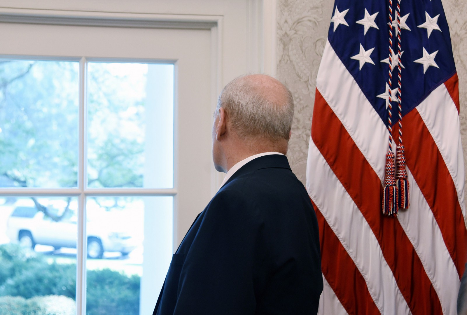 """White House Chief of Staff John Kelly looks outside during a meeting between US President Donald Trump and Nikki Haley, the United States Ambassador to the United Nations in the Oval office of the White House on October 9, 2018 in Washington, DC. - Nikki Haley resigned Tuesday as the US ambassador to the United Nations, in the latest departure from President Donald Trump's national security team. Meeting Haley in the Oval Office, Trump said that Haley had done a """"fantastic job"""" and would leave at the end of the year. (Photo by Olivier Douliery / AFP)"""