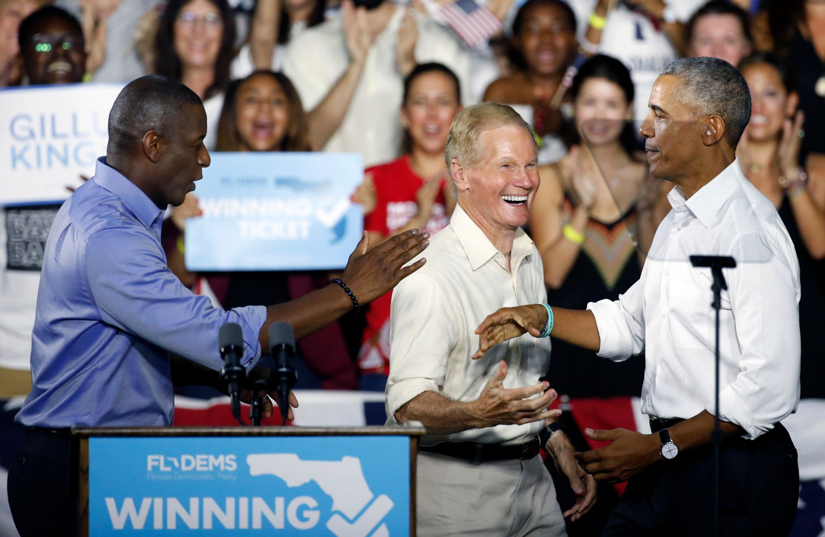 President Barack Obama (C) greets Florida Democratic gubernatorial nominee Andrew Gillum (L), and Senator Bill Nelson (D-FL) at a rally in Miami, Florida November 2, 2018. (Photo by RHONA WISE / AFP)