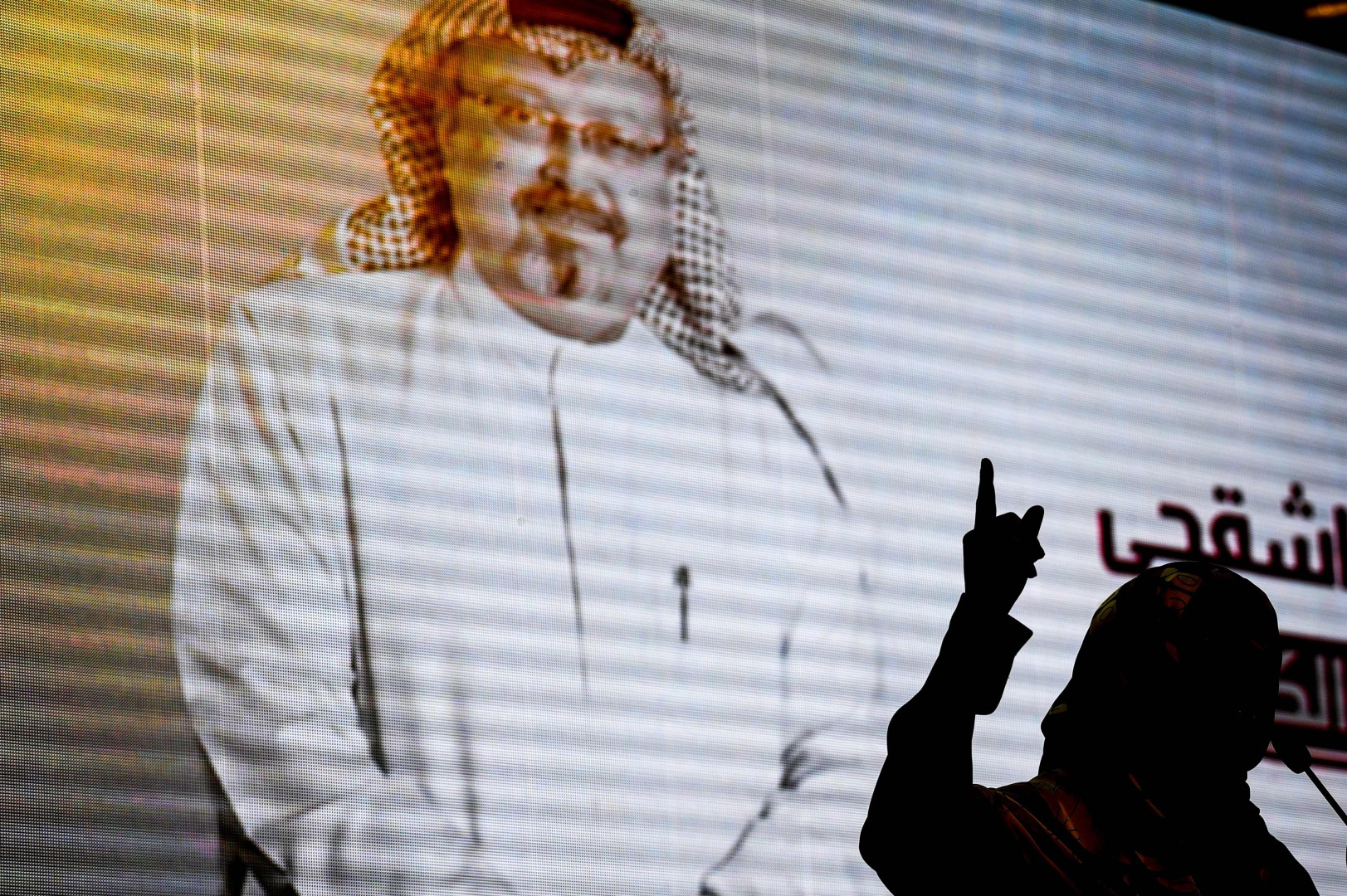 Nobel Peace Prize laureate Yemeni Tawakkol Karman stands in front of a digital image of Jamal Khashoggi as she speaks during a commemoration event of Khashoggi's supporters on November 11, 2018 in Istanbul. - US Secretary of State Mike Pompeo told Saudi Crown Prince Mohammed bin Salman on November 11, 2018 that the US will hold accountable all involved in killing a dissident Saudi journalist. (Photo by OZAN KOSE / AFP)