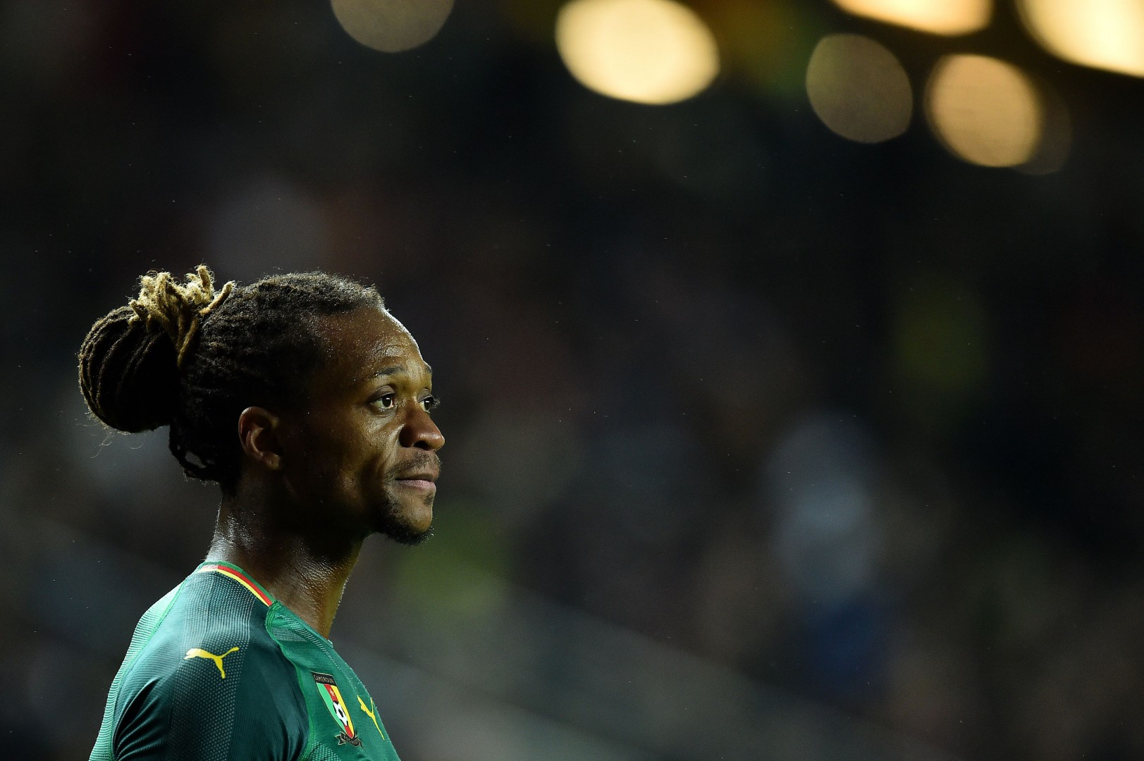 Cameroon's defender Gaetan Bong reacts during the international friendly football match between Brazil and Cameroon at Stadium MK in Milton Keynes, central England, on November 20, 2018. (Photo by Glyn KIRK / AFP)