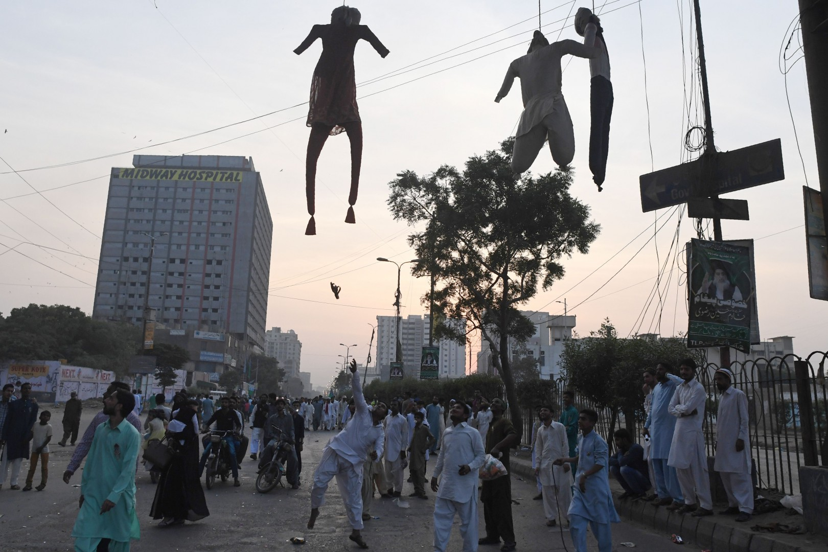 Islamist students throw footwear toward effigies representing Asia Bibi, a Pakistani Christian woman who was recently released after spending eight years on death row for blasphemy, during a rally coinciding with Eid Milad-un-Nabi, which marks the birth anniversary of Prophet Muhammad, in Karachi on November 21, 2018. (Photo by ASIF HASSAN / AFP)