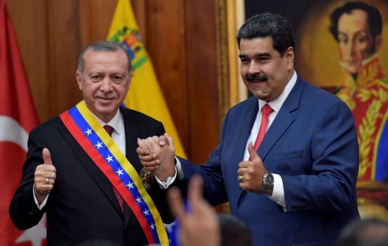 TOPSHOT - Venezuelan President Nicolas Maduro (R) and Turkish President Recep Tayyip Erdogan are pictured at Miraflores Presidential Palace in Caracas, on December 3, 2018. (Photo by Yuri CORTEZ / AFP)