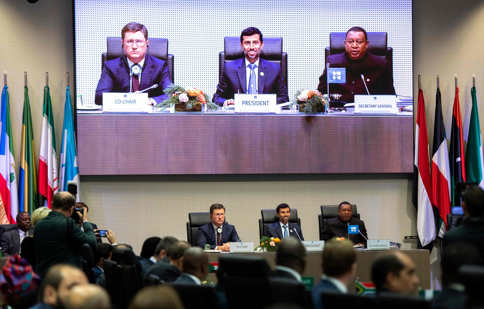 (LtoR) Russian Minister of Energy of Russia Alexander Novak, Organization of the Petroleum Exporting Countries' (OPEC) President UAE Energy Minister Suhail al-Mazroueiand OPEC Secretary General Mohammed Sanusi Barkindo of Nigeria speak during a ministerial level meeting during with OPEC members and non members during the 175th OPEC Conference on December 7, 2018 in Vienna, Austria. (Photo by JOE KLAMAR / AFP)