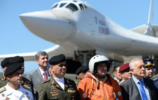 Venezuelan Defence Minister Vladimir Padrino (2-L) is pictured after the arrival of two Russian Tupolev Tu-160 strategic long-range heavy supersonic bomber aircrafts at Maiquetia International Airport, just north of Caracas, on December 10, 2018. - Venezuela and Russia will hold joint air force exercises for the defence of the South American country, Padrino announced on Monday. Padrino welcomed about 100 Russian pilots and other personnel after the Tu-160s and two other aircraft landed at the international airport that serves Caracas. (Photo by Federico PARRA / AFP)