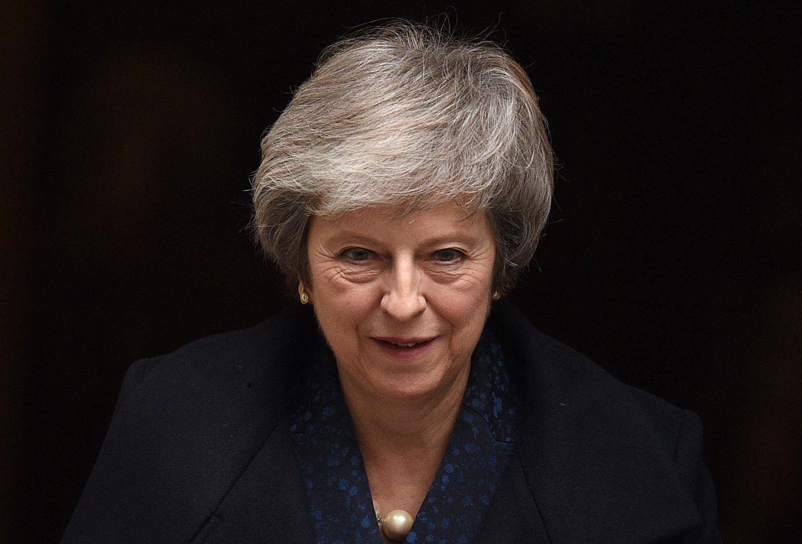 "Britain's Prime Minister Theresa May leaves 10 Downing Street in central London on December 12, 2018 ahead of the weekly question and answer session, Prime Ministers Questions (PMQs), in the House of Commons. - British Prime Minister Theresa May was hit by a no-confidence motion by her own party on December 12 over the unpopular Brexit deal she struck with EU leaders last month. Facing her biggest crisis since assuming office a month after Britons voted in June 2016 to leave Europe, May vowed to fight the coup attempt inside her own Conservative Party ""with everything I've got"". (Photo by Oli SCARFF / AFP)"