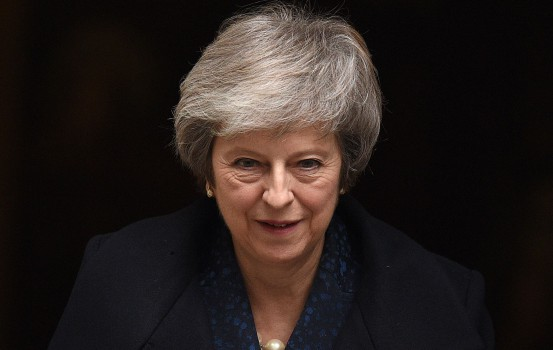 """Britain's Prime Minister Theresa May leaves 10 Downing Street in central London on December 12, 2018 ahead of the weekly question and answer session, Prime Ministers Questions (PMQs), in the House of Commons. - British Prime Minister Theresa May was hit by a no-confidence motion by her own party on December 12 over the unpopular Brexit deal she struck with EU leaders last month. Facing her biggest crisis since assuming office a month after Britons voted in June 2016 to leave Europe, May vowed to fight the coup attempt inside her own Conservative Party """"with everything I've got"""". (Photo by Oli SCARFF / AFP)"""