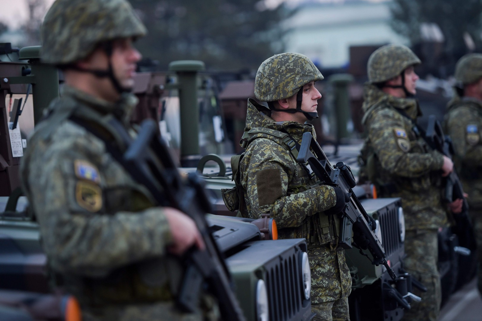 "Members of the Kosovo Security Force (KSF) stand at attention during the visit of Kosovo President at the ""Adem Jashari"" barracks in Pristina on December 13, 2018. - Kosovo will vote Friday on whether to create its own army, in a heavily symbolic show of independence from Serbia that has inflamed tensions between the former wartime foes. (Photo by Armend NIMANI / AFP)"
