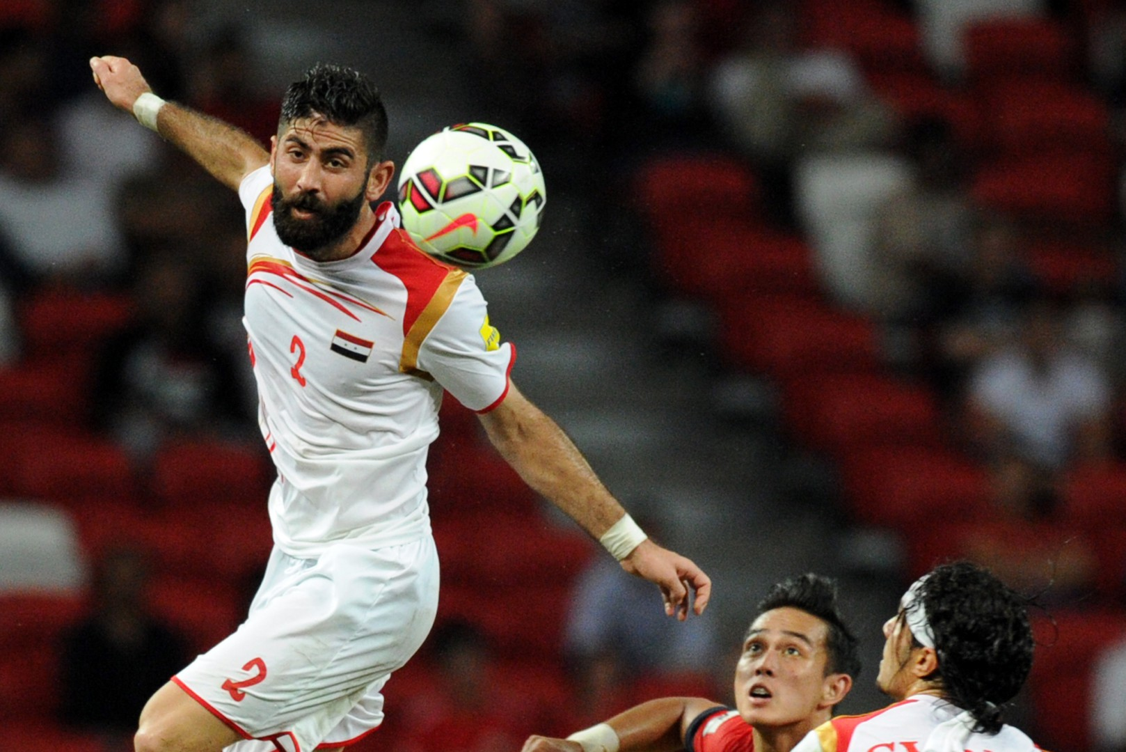 (151117) -- SINGAPORE, Nov. 17, 2015 (Xinhua) -- Syria's Ahmad Alsaleh (L) heads the ball during the 2018 FIFA World Cup Group E Asia qualifier match between Singapore and Syria at Singapore's National Stadium, Nov. 17, 2015. Singapore lost 1-2. (Xinhua/Then Chih Wey) ****Authorized by ytfs****