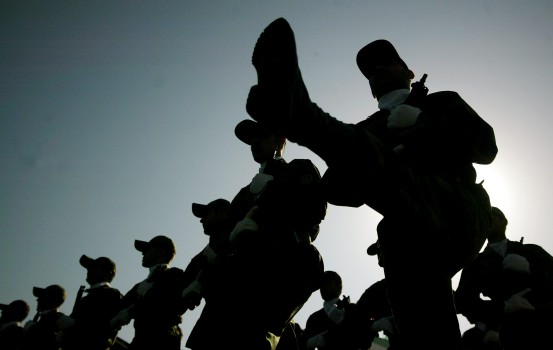 ©UPI/Lapresse 22-09-2007 Iran Estero Parata  per il 27¡ anniversario della guerra Iran-Iraq  nella foto: la parata  An Iranian army soldier stands guard in front of photos of Iranian commanders who were killed in the Iran-Iraq war (1980-88) during a parade marking the 27th anniversary of the outset of the Iran-Iraq war (1980-1988) in front of the mausoleum of the late revolutionary founder Ayatollah Ruhollah Khomeini, just outside Tehran, Iran on September 22, 2007. (UPI Photo/Mohammad Kheirkhah)