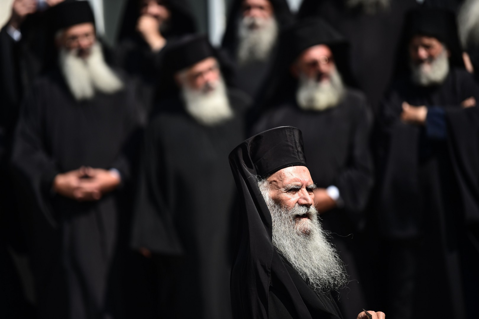 Orthodox clergies prepare for a family photo at The Hagia Triada Greek Orthodox church on September 2, 2018 in Istanbul, during the second day of meeting (synaxis) of the Hierarchy of the Ecumenical throne. - Ecumenical Patriarch Bartholomew I on August 31 hosted Russian Orthodox Patriarch Kirill in Istanbul for hugely unusual talks focused on whether Ukraine will get an independent church, a move strongly opposed by Moscow. (Photo by OZAN KOSE / AFP)