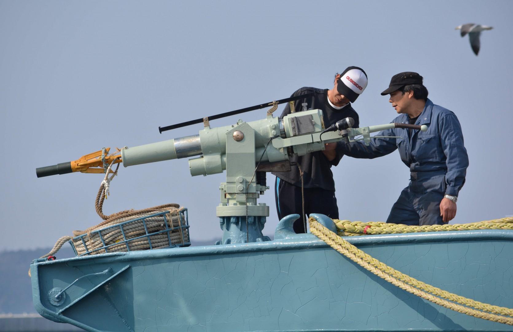 (FILES) In this file photo taken on April 25, 2014 crew members of a whaling ship check a whaling gun or harpoon before departure at Ayukawa port in Ishinomaki City. - On September 10, 2018 pro- and anti-whaling nations locked horns as the International Whaling Commission (IWC) began meeting in Brazil amid outrage over Japan's proposal to end a three-decade moratorium on commercial whale hunting. (Photo by Kazuhiro NOGI / AFP)