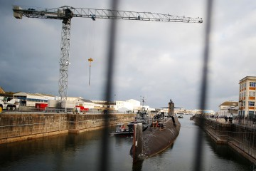 "The French navy submarine called ""Le Tonnant"" launched in 1977, armed in 1980 and disarmed and denuclearized in 1999 is pictured in the Naval Group plant in Cherbourg-Octeville, north-western France on September 11, 2018. - From September 11, 2018 to 2027, ""Le Tonnant"" and four others submarines will be dismantled. ""Le Tonnant"" is the first nuclear submarine of the first generation ""SNLE"" (Sous Marins Nucleaires Lanceurs d'Engins) to be dismantled. (Photo by CHARLY TRIBALLEAU / AFP)"