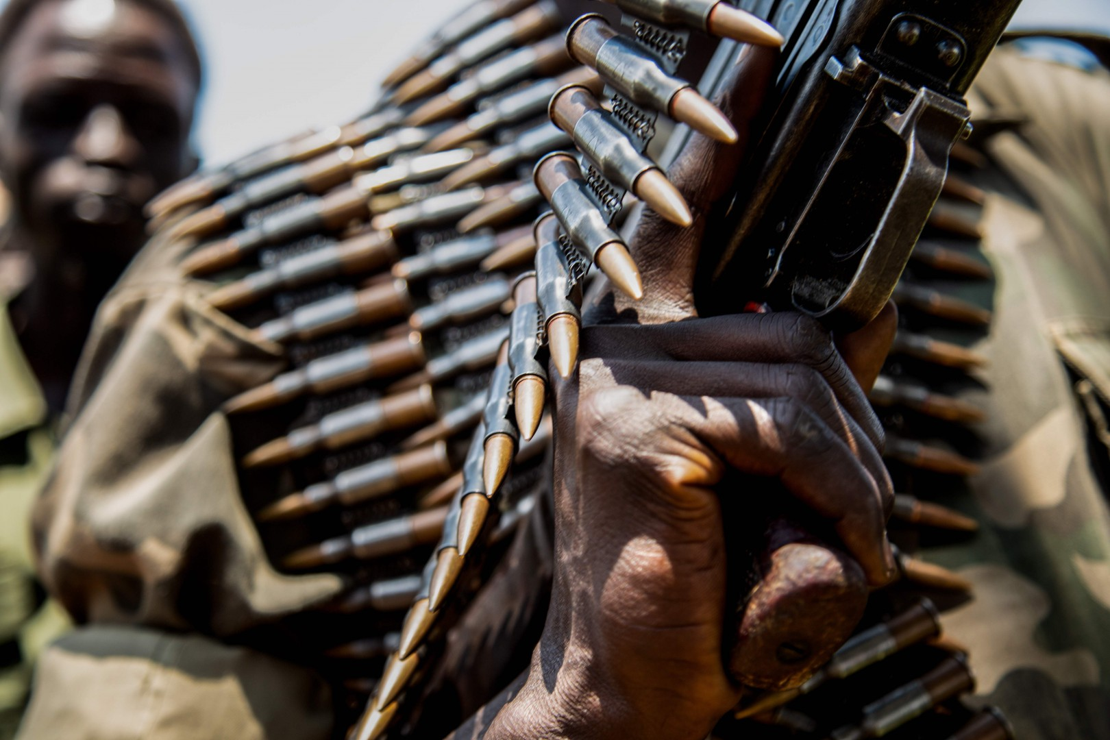 Rebels of the Sudan People's Liberation Movement-in-Opposition (SPLM-IO), a South Sudanese anti-government force, hold ammunitions which they say were confiscated from government forces during fighting as they take part in a military exercise on September 22, 2018, at their base in Panyume, South Sudan, near the border with Uganda. - Despite a peace deal being signed by the President of South Sudan, Salva Kiir, and opposition leader Riek Machar on September 12, conflict in Central Equatoria continues as both warring parties fight for control. (Photo by SUMY SADURNI / AFP)