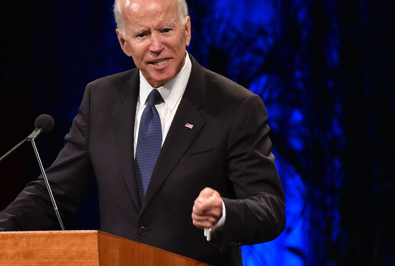 "(FILES) In this file photo taken on August 30, 2018 former US vice president Joe Biden speaks during the memorial service for the late US Senator John McCain at the North Phoenix Baptist Church in Phoenix, Arizona. - Democratic former US vice president Joe Biden has conceded that his advanced years would be an issue if he ran for president in 2020. At 75, Biden is three years older than Republican President Donald Trump and would be 77 by the time his party's primary contest got underway.""I think age is a totally legitimate thing to raise,"" said Biden, who was vice president under Barack Obama, during a speech in Michigan on October 16, 2018. (Photo by Robyn Beck / AFP)"