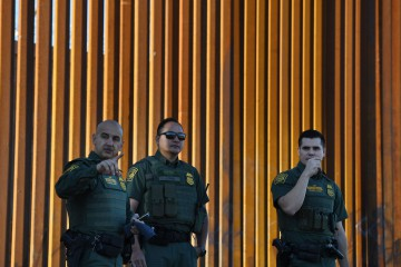 Border Patrol officers keep watch before US Department of Homeland Security Secretary Kirstjen M. Nielsen inaugurates the first completed section of President Trumpís 30-foot border wall in the El Centro Sector, at the US Mexico border in Calexico, California on October 26, 2018. (Photo by Mark RALSTON / AFP)