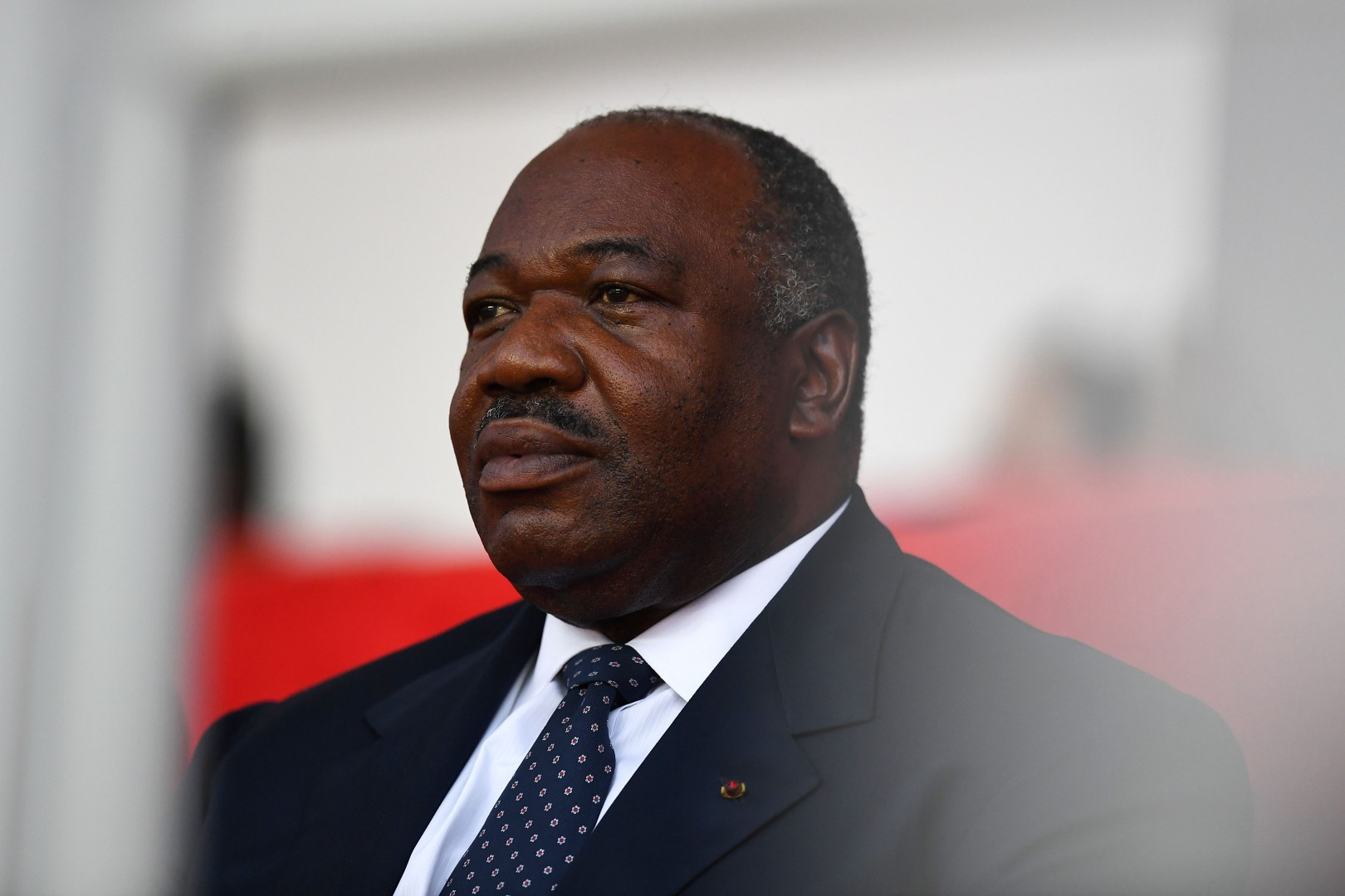 (FILES) In this file photo taken on February 05, 2017 Gabonese President Ali Bongo Ondimba attends the closing ceremony of the 2017 Africa Cup of Nations football tournament at the Stade de l'Amitie Sino-Gabonaise in Libreville. - Gabon's President Ali Bongo, who has spent a month in treatment at a Saudi hospital, has left Riyadh, state media in the kingdom reported, without saying where he went. As he departed King Salman airbase late on November 28, 2018, Bongo was seen off by officials from the Saudi foreign ministry, the official Saudi Press Agency said. (Photo by GABRIEL BOUYS / AFP)