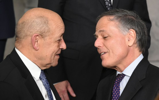 French Foreign Affairs Minister Jean-Yves Le Drian (L) talks with Italian Foreign Minister Enzo Moavero Milanesi after posing for a family picture during a foreign minister meeting at the NATO headquarters in Brussels on December 4, 2018. (Photo by JOHN THYS / AFP)