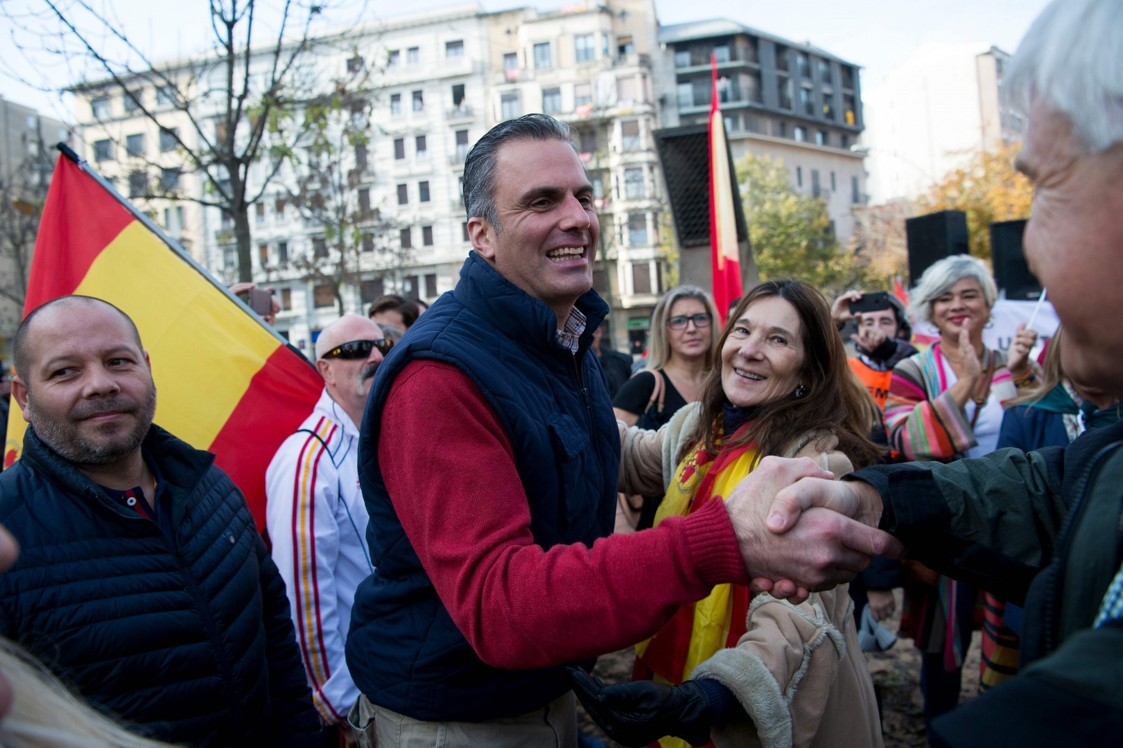 """Spain's far-right party VOX secretary general Javier Ortega Smith shakes hands with supporters during a far-right demonstration untitled """"United for the Constitution"""" in Girona on December 6, 2018,  on the 40th anniversary of the Spanish Constitution. (Photo by Josep LAGO / AFP)"""