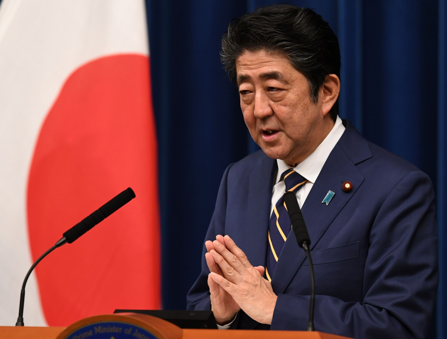 Japan's Prime Minister Shinzo Abe answers a question during a press conference at his official residence in Tokyo on December 10, 2018. (Photo by Toshifumi KITAMURA / AFP)